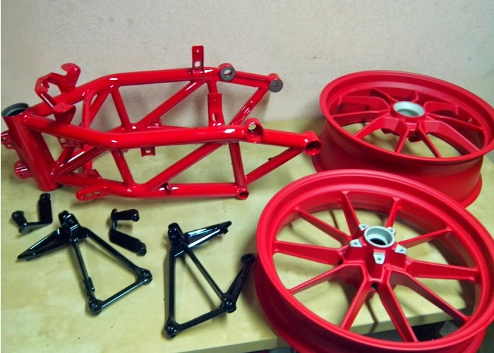 Powder coating motorcycle parts, alloy wheels